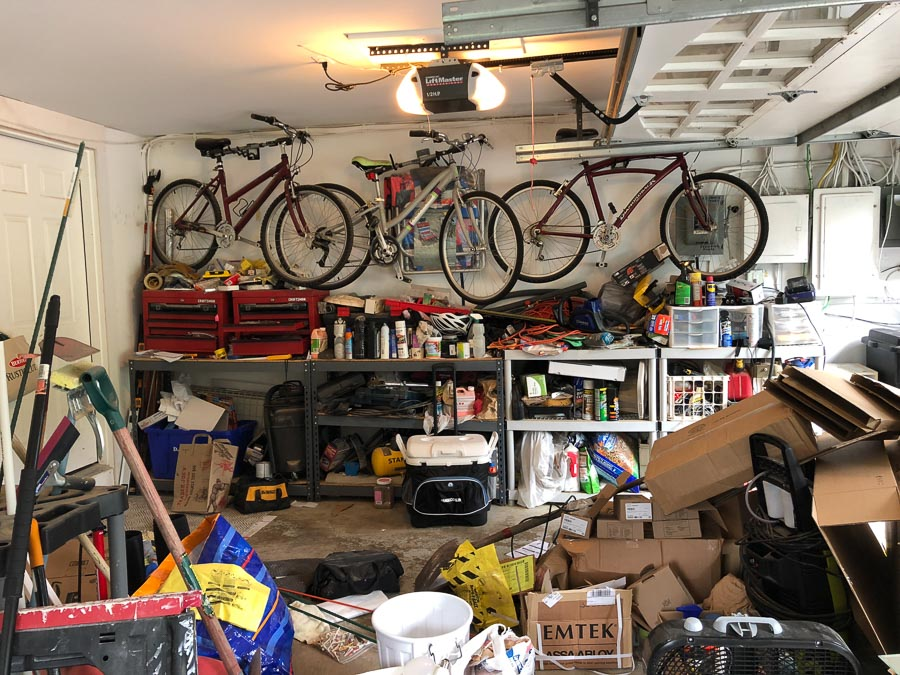 Our horribly messy garage before with organized it with The Container Store's Elfa system