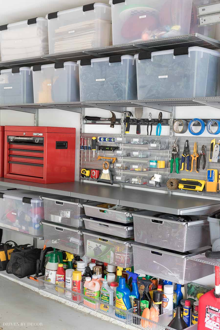 Love the smooth, heavy duty Elfa utility work surface integrated into this organized garage system!