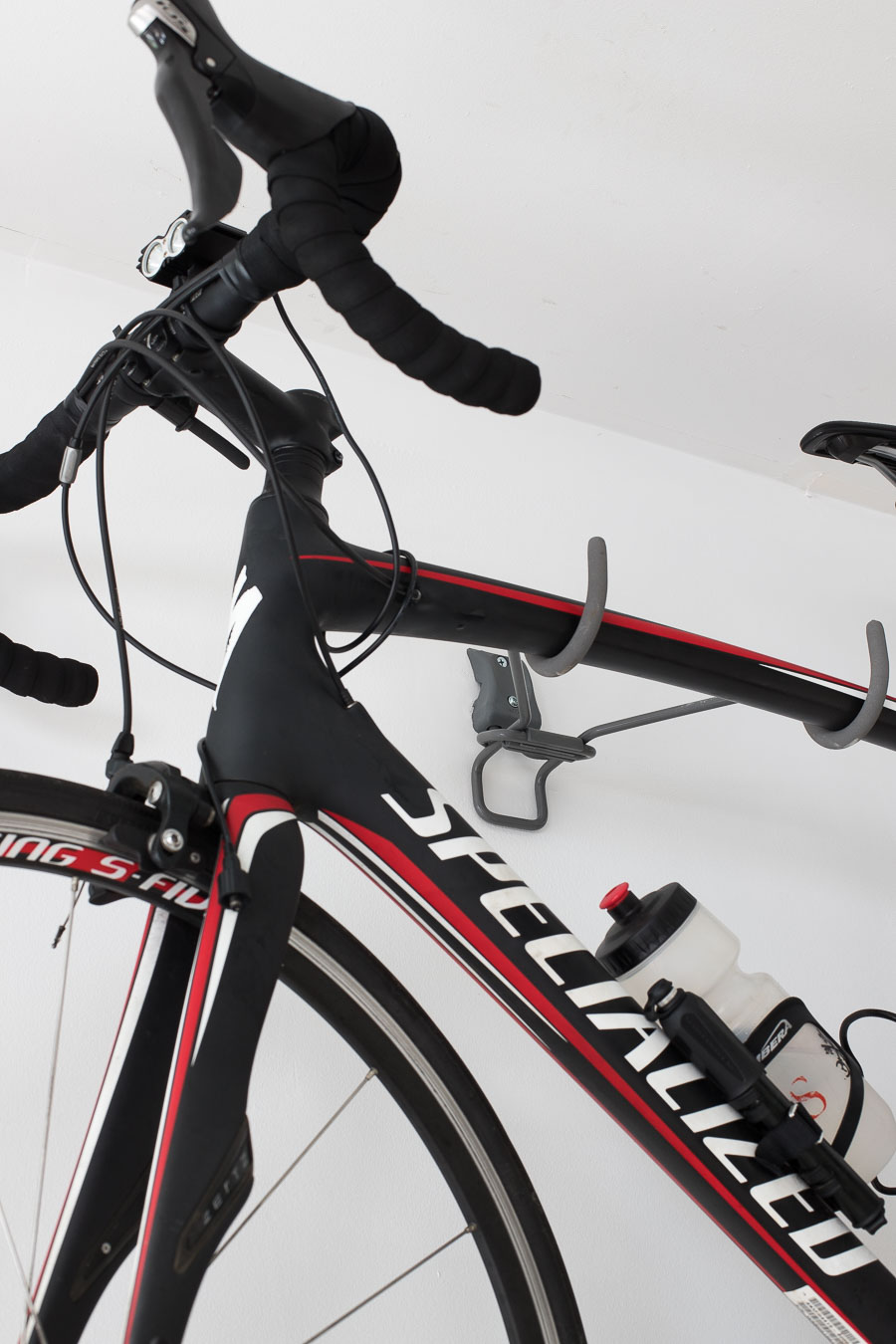A smart way to hang your bike on the wall in the garage - an Elfa wall-mounted bike rack!