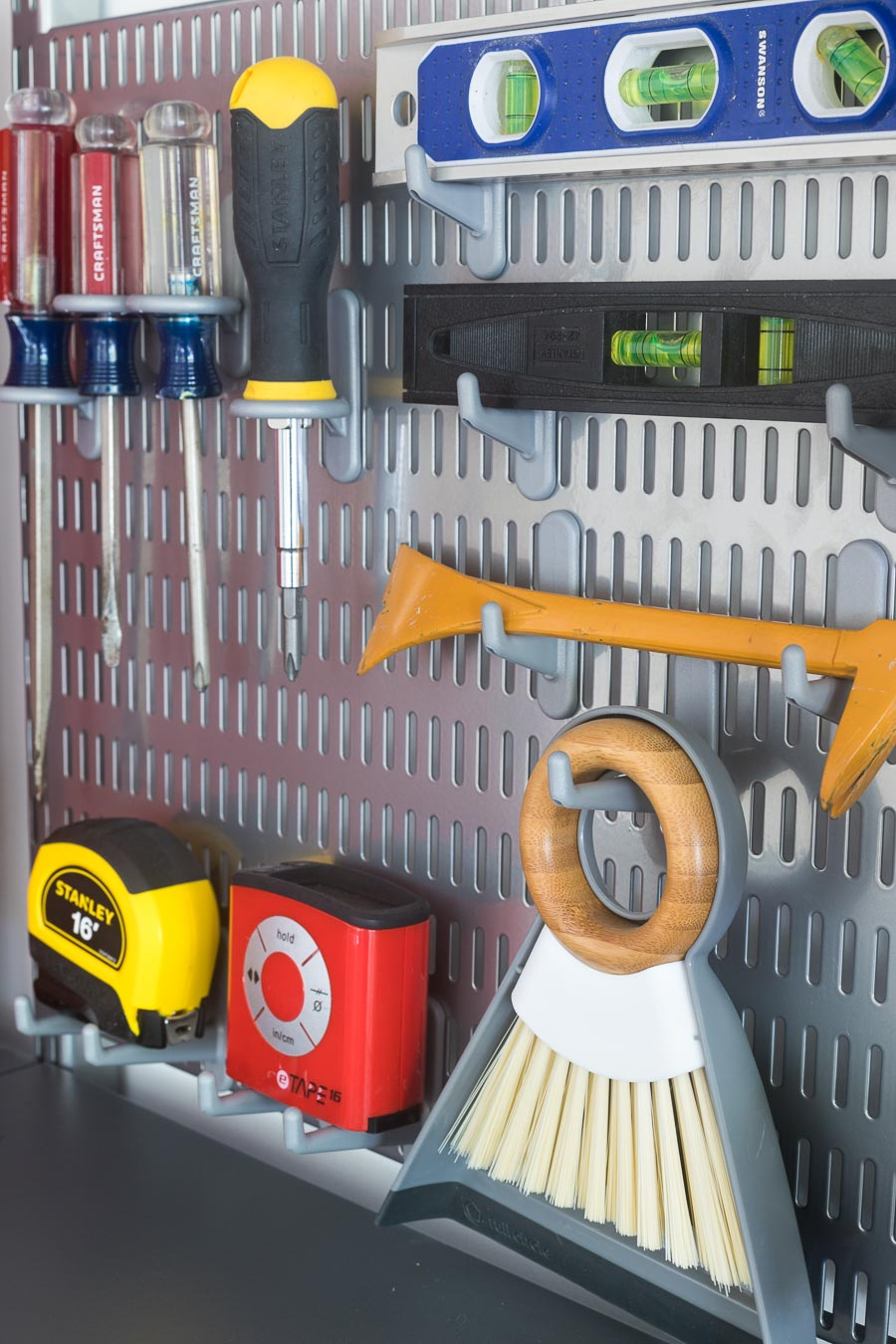 The smartest was to organize your most-used tools! She used Elfa utility boards with different types of board hooks to hold screwdrivers, levels, and more!