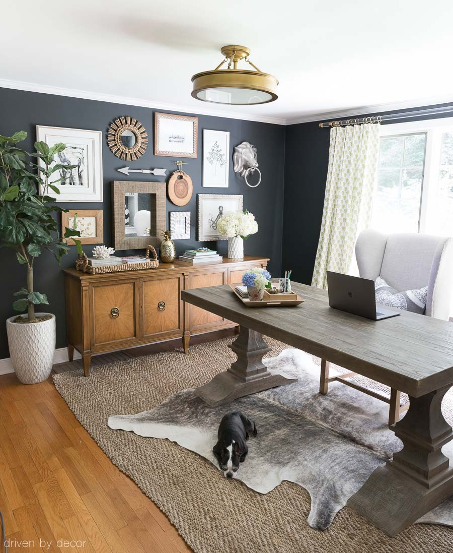 Reclaimed wood trestle table used as a desk in our home office!