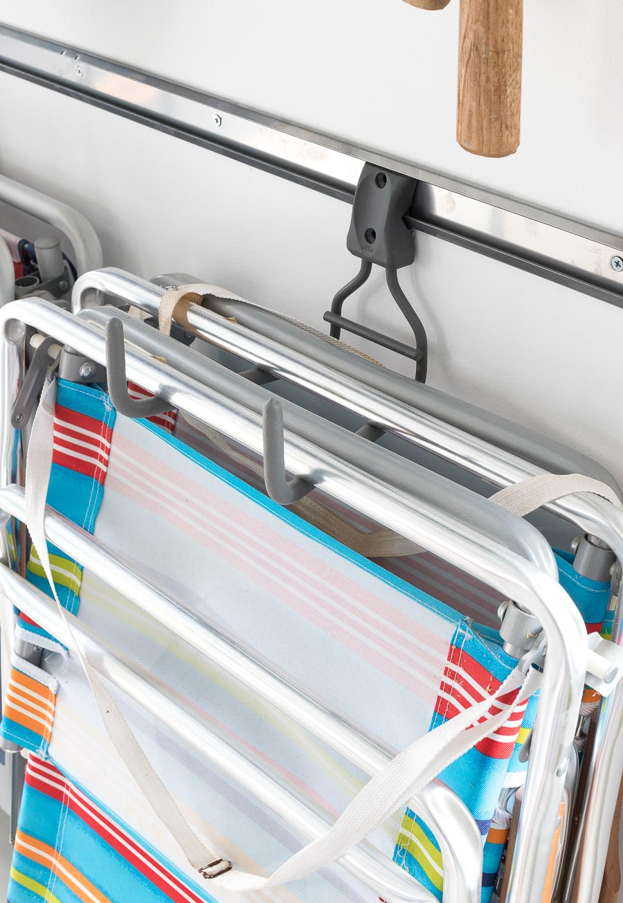 Definitely a garage must-have! These Elfa wide ladder hooks are perfect for holding folding chairs and sawhorses in addition to ladders! Love how this garage is organized!