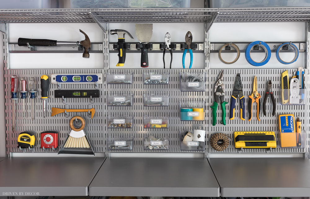 How I organized my most used hardware and tools in our garage! Love Elfa's utility boards, hooks, and bins!