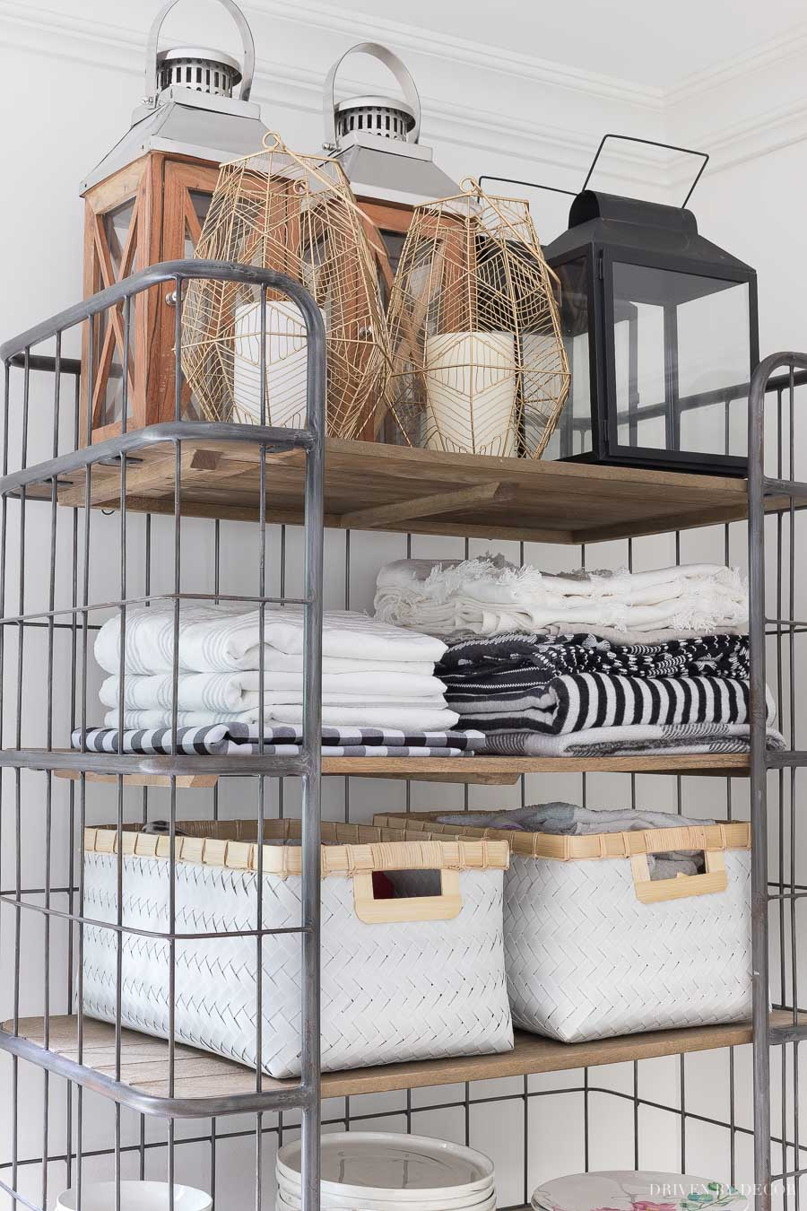 Our open rolling baker's rack holds extra tablecloths, outdoor throws, bins with dog supplies, and more!