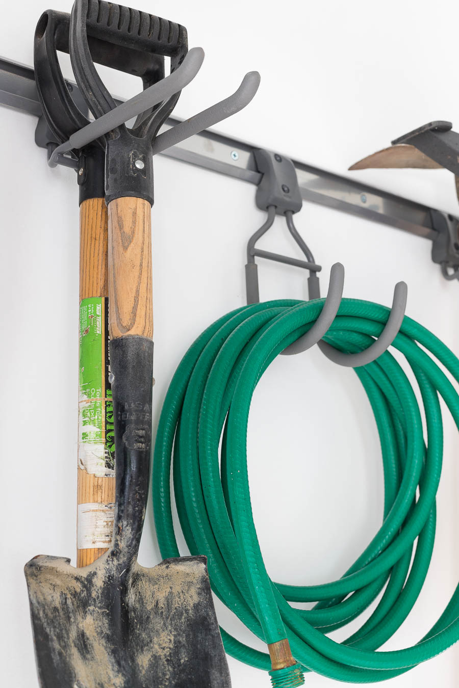 Super Smart Tool Hooks That Are Part Of The Elfa Garage Organizing System Organize Hoses