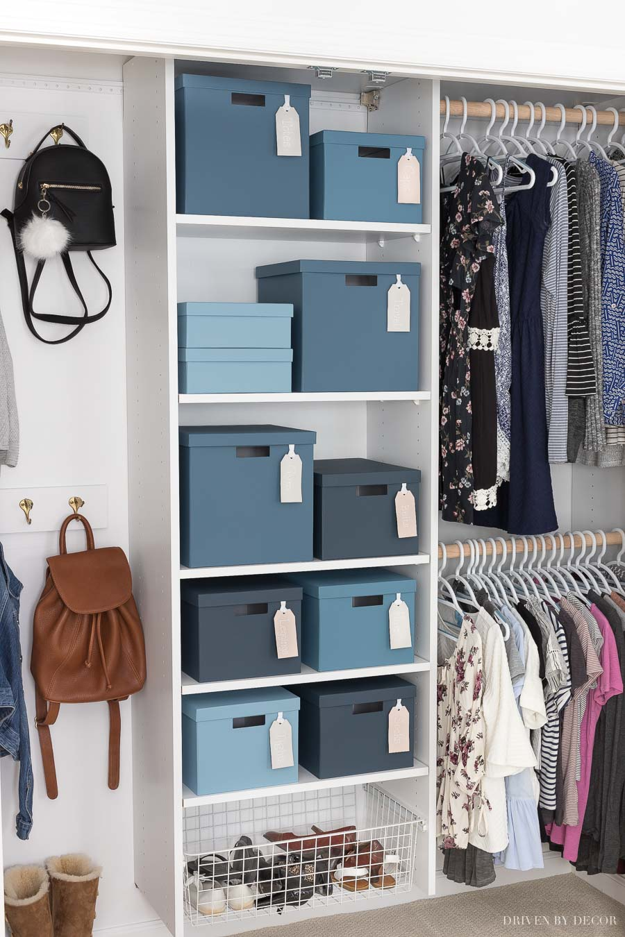 Closet system painted with with blue painted boxes for storage - so cute!
