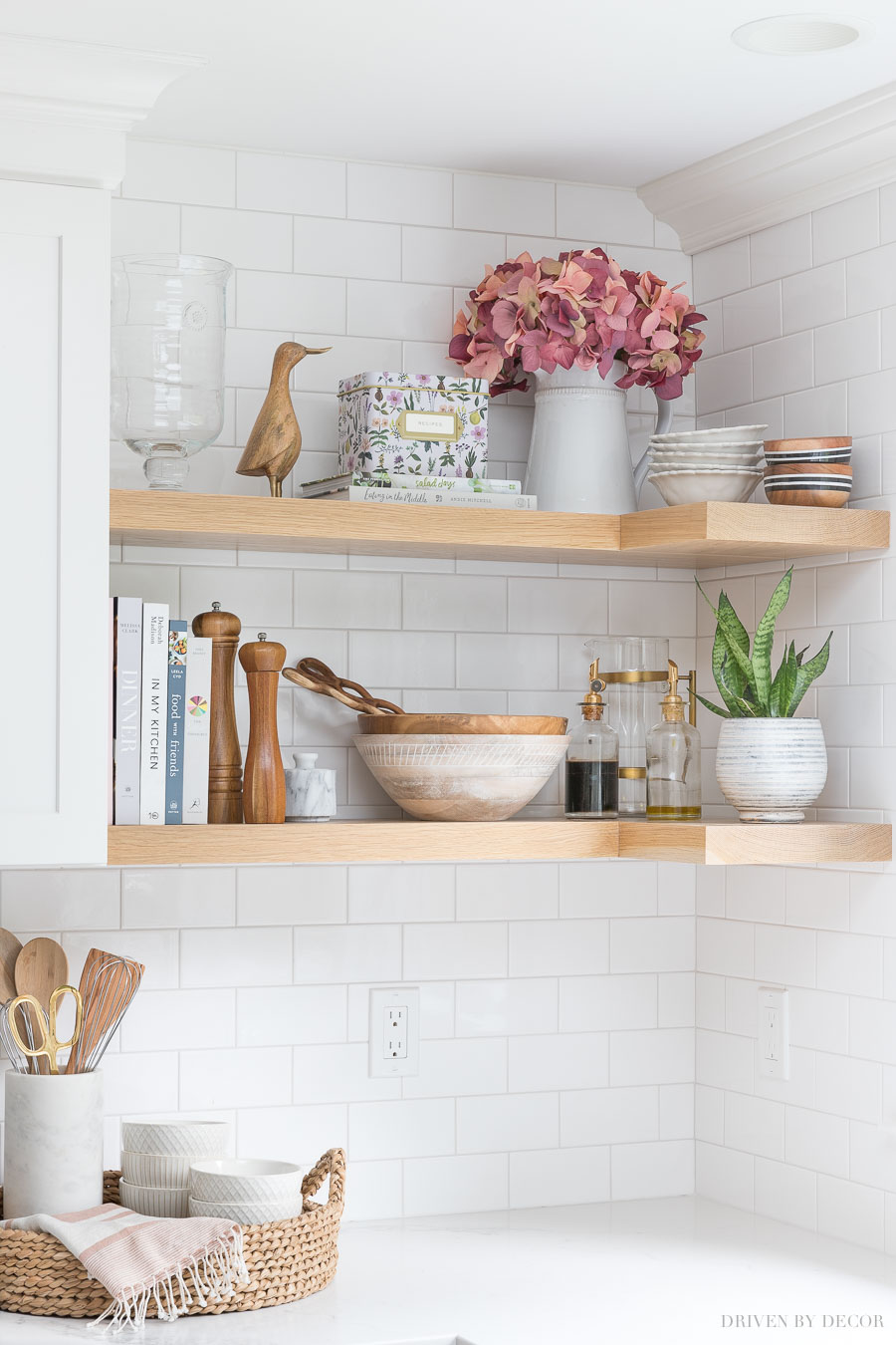 Faux hydrangeas that look real! Love them in a pitcher on this open kitchen shelving!
