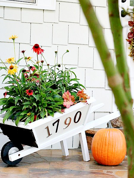 DIY wheelbarrow fall planter by Laura of Duke Manor Farm!
