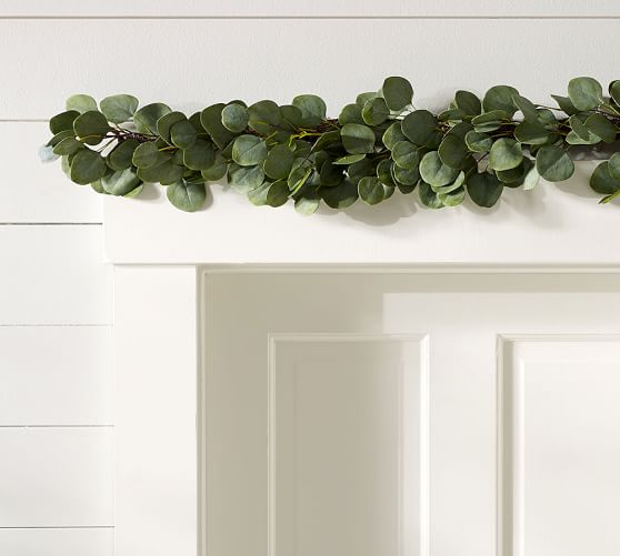 Gorgeous faux eucalyptus garland for a holiday fireplace mantel!