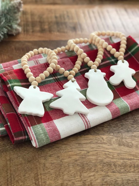 The cutest beaded napkin rings with classic clay Christmas shapes!