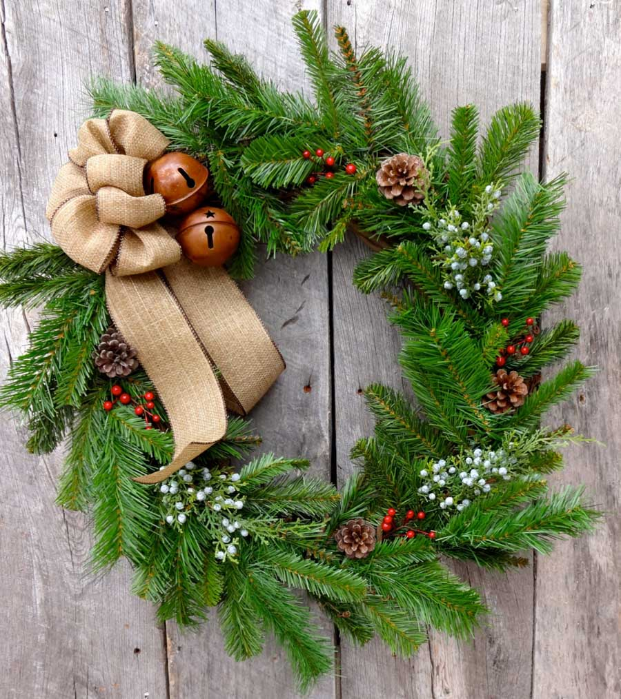 Gorgeous Christmas wreath with jingle bells, pinecones, and berries