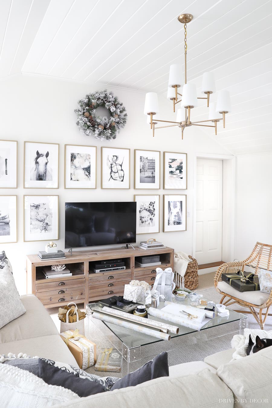 Love this two-tiered brass chandelier! So perfect in this family room!