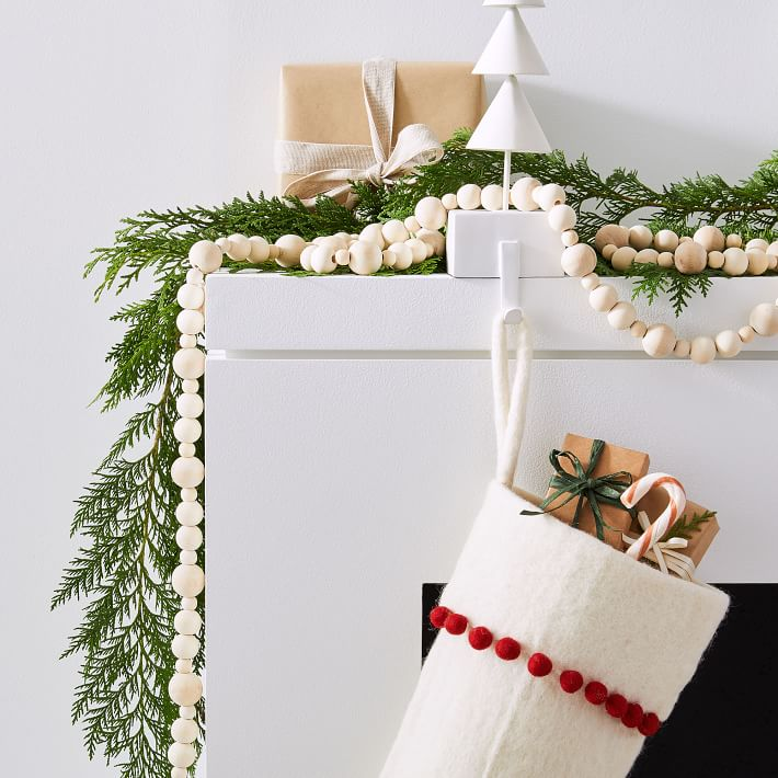 Gorgeous wood bead garland for Christmas! Looks beautiful intertwined with greenery on a mantel!