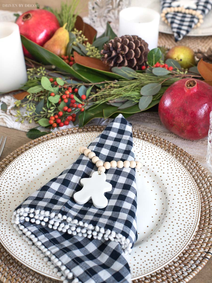 These wood bead + clay napkin rings are the cutest for Christmas! Source linked in post!