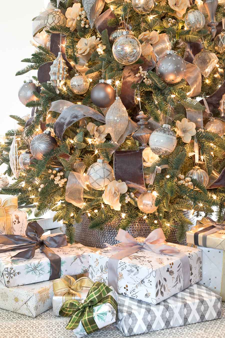 Love this silver Christmas tree collar used instead of a tree skirt!