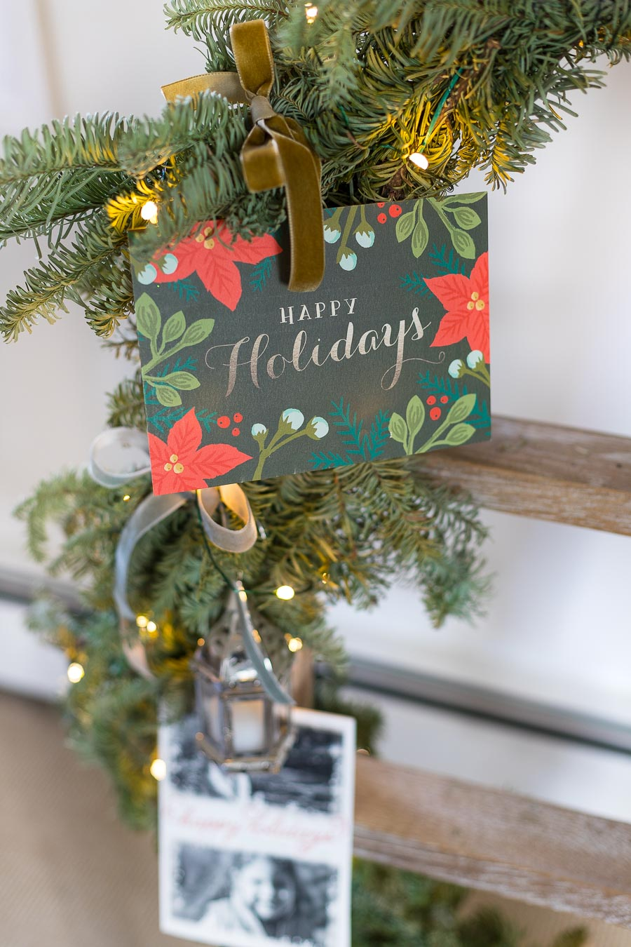 Love this way of displaying Christmas cards by tying them onto a garland wrapped ladder!