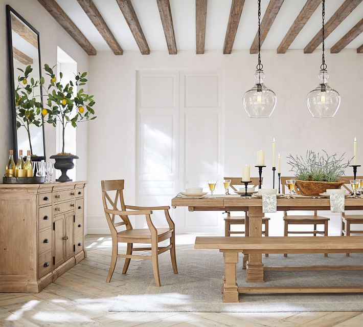 Loving the look of wood beams added to the ceiling of this dining room!