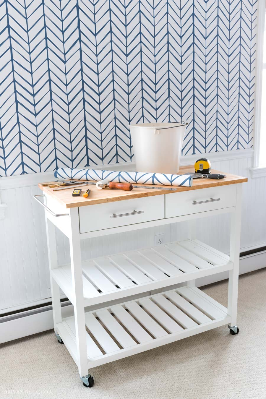 This rolling kitchen cart is so helpful for holding supplies while wallpapering or painting!