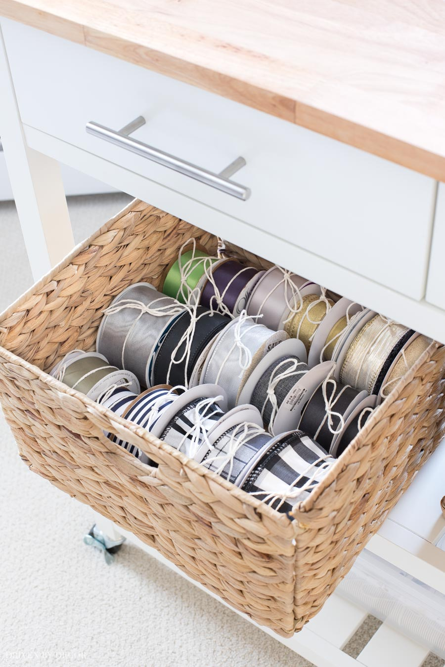 A woven basket holds spools of ribbon in this super cute and functional gift wrapping station!