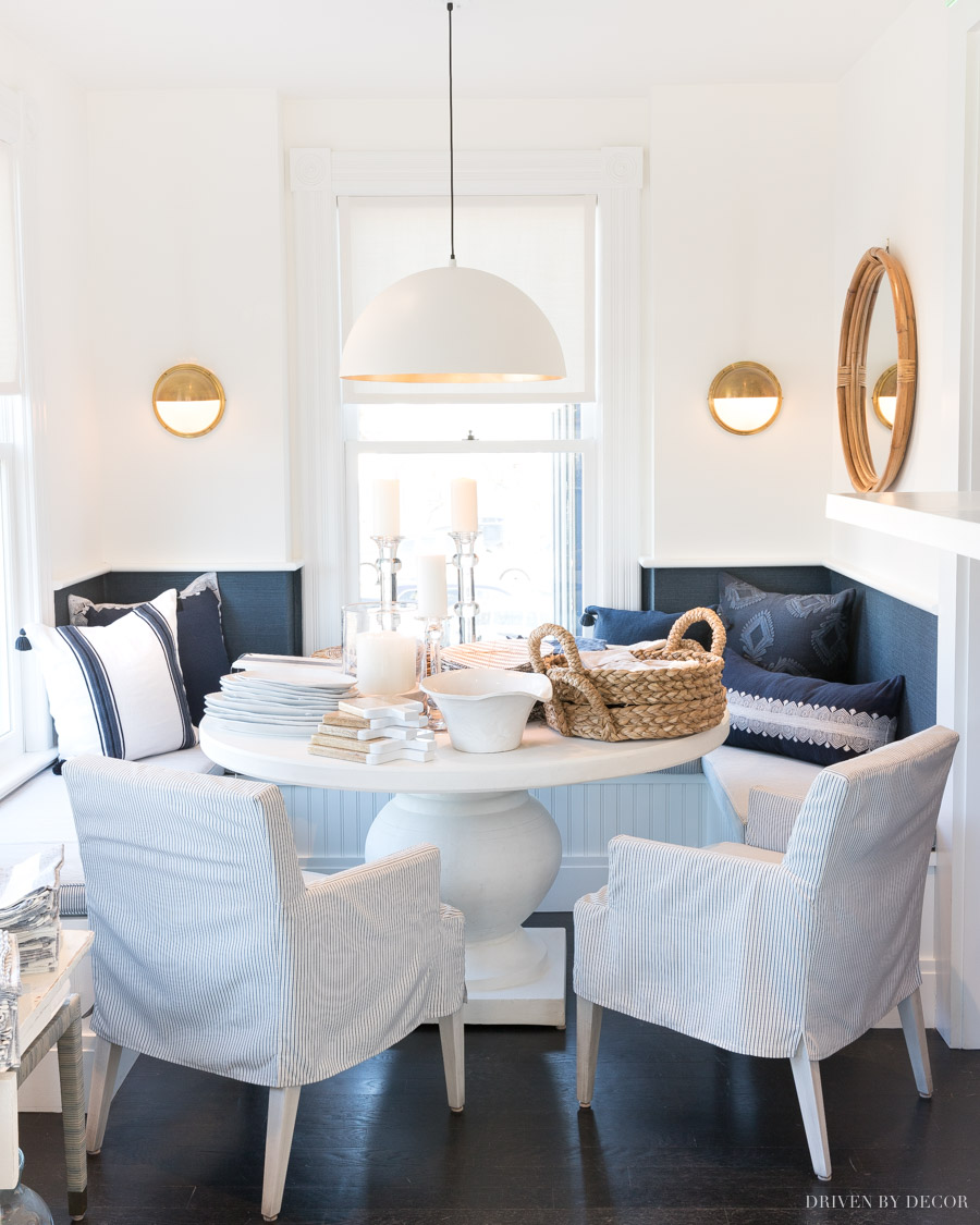 Stunning built-in banquette with blue and white decor