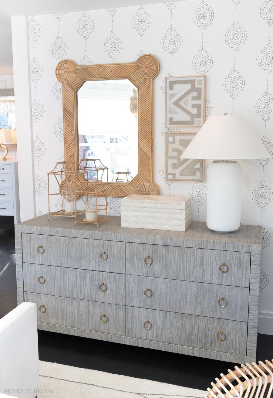 Adding texture to a space does so much for warming it up! Love this raffia console and rattan mirror!