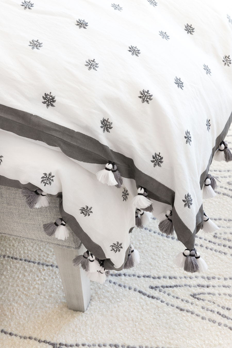 Gorgeous gray and white duvet cover with tasseled ends!