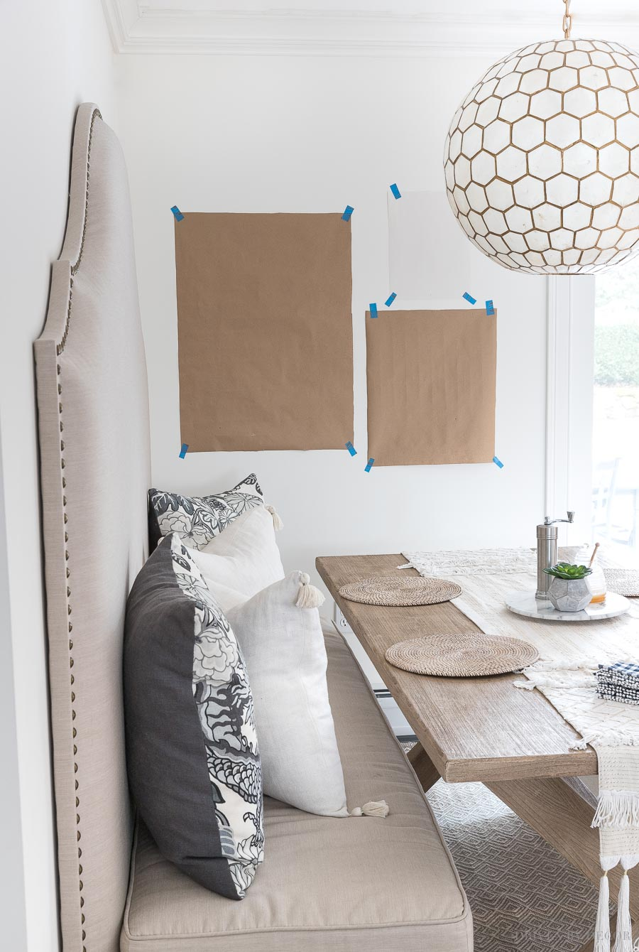 Tips on how to hang pictures using paper templates!