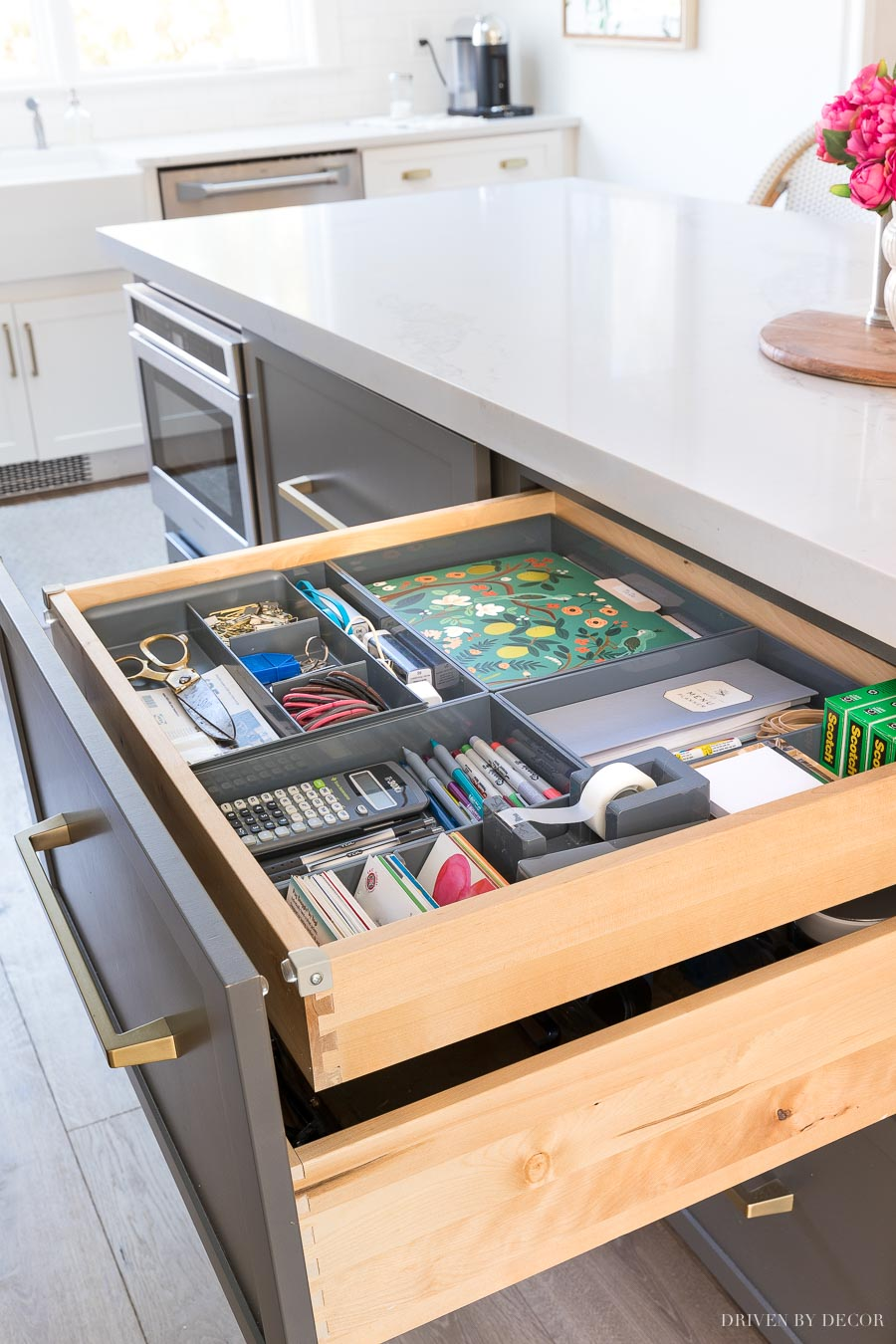 I need this! A hidden kitchen command center organized in a shallow drawer!