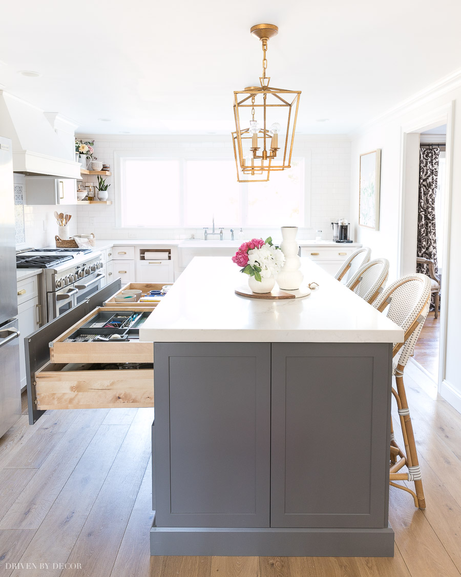 Love the idea of a smaller rolling drawer within the larger drawers of this kitchen island!