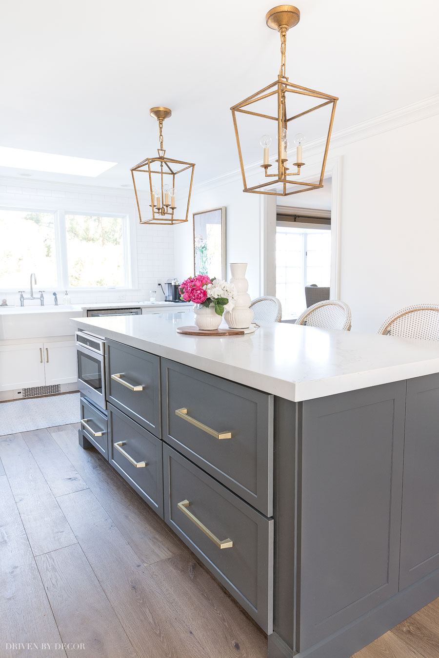 Loving the hidden kitchen command center in the drawer within the drawer of this kitchen island!