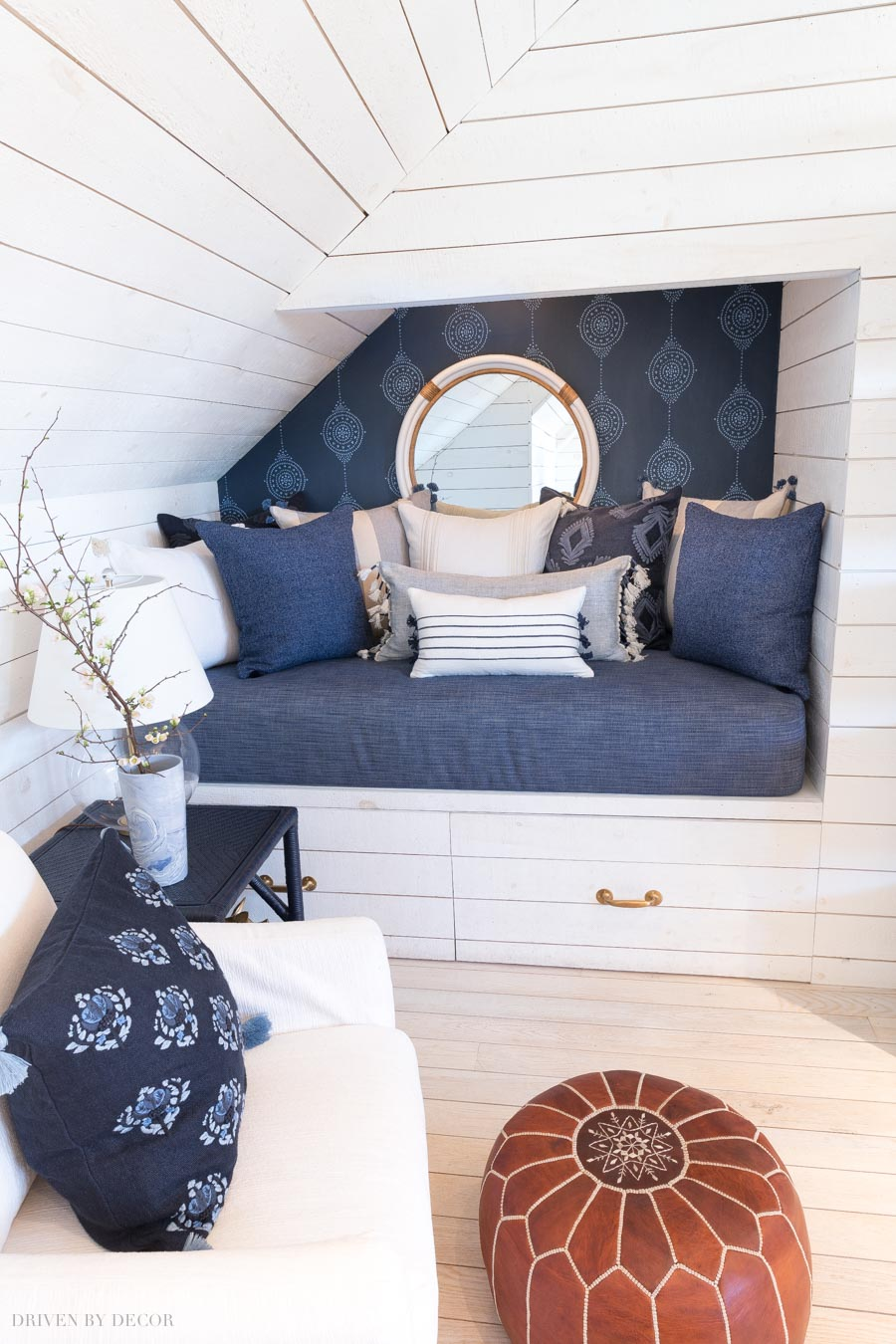 Gorgeous blue on blue wallpaper in this super cozy bed nook!