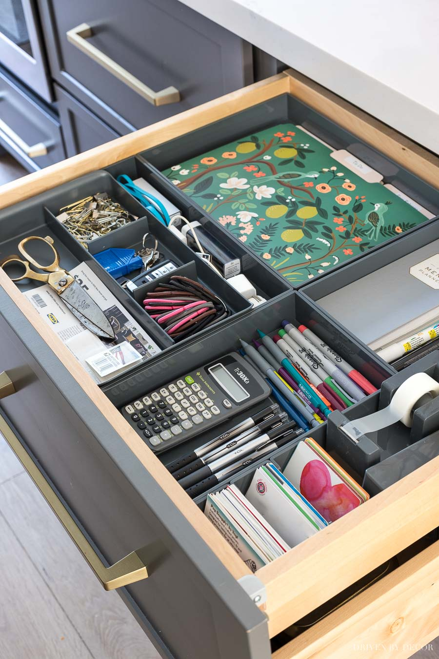 So smart! Hidden kitchen command center organized in a shallow kitchen drawer!