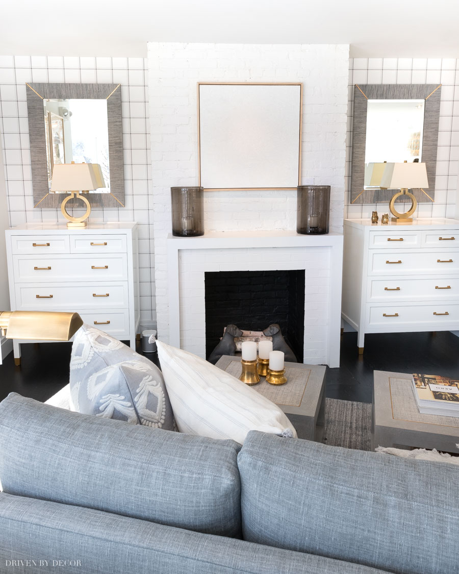 Gorgeous plaid wallpaper! Love the pop of pattern on both sides of the fireplace in this living room!