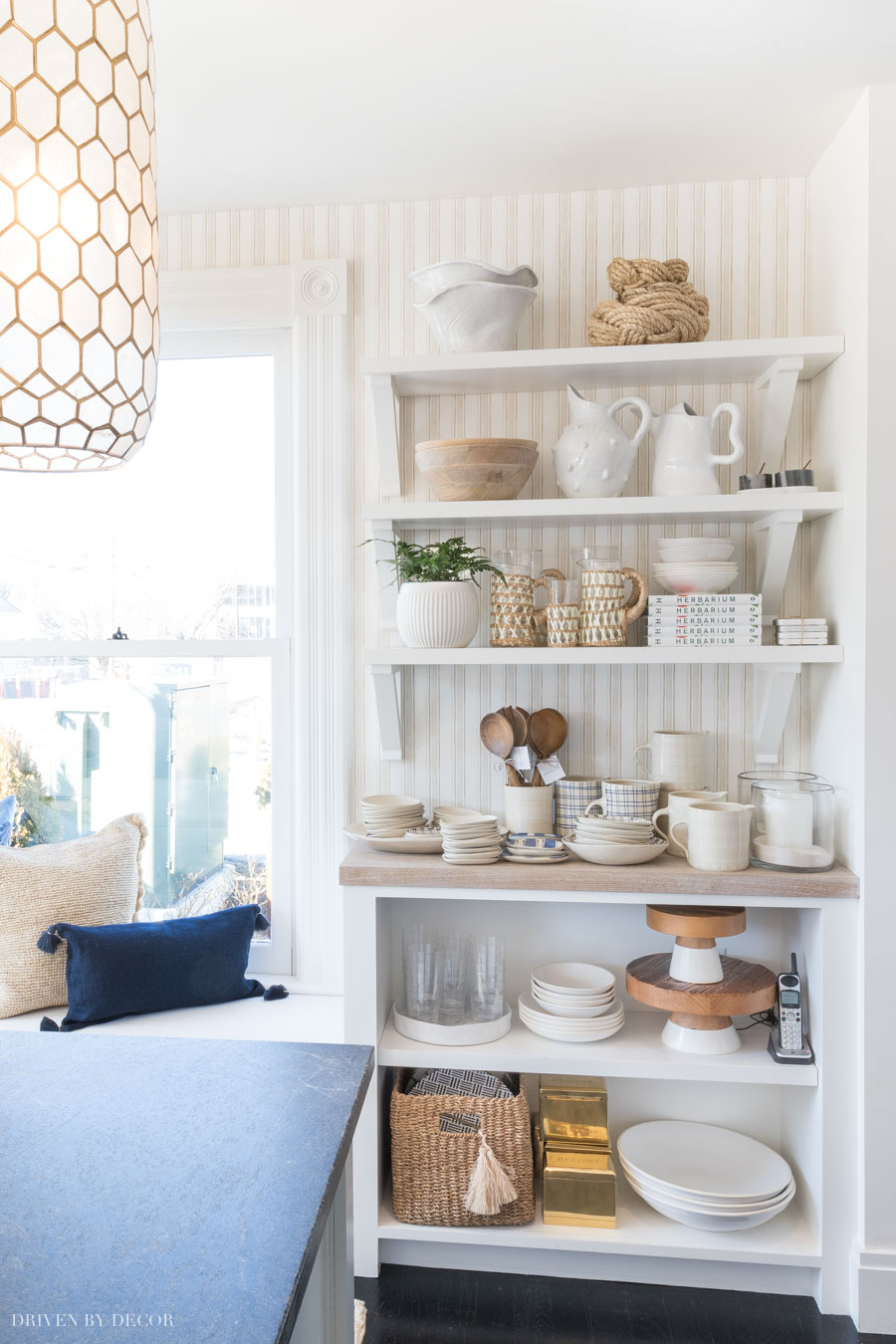 Love the look of this striped wallpaper behind open shelving!