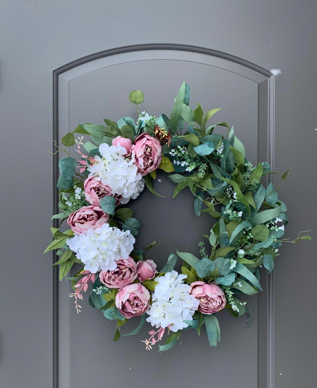 Gorgeous spring front door wreath with pink peonies! Sourced in blog post!