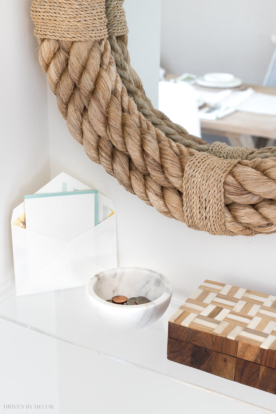 Love this stylish acrylic shelf for holding change, keys, and mail as you go in or out through this entryway!