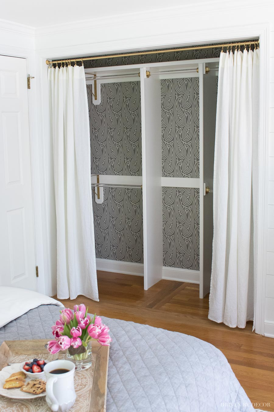 One of my favorite closet door ideas in this post! Removing the bifold doors and replacing them with drapes!