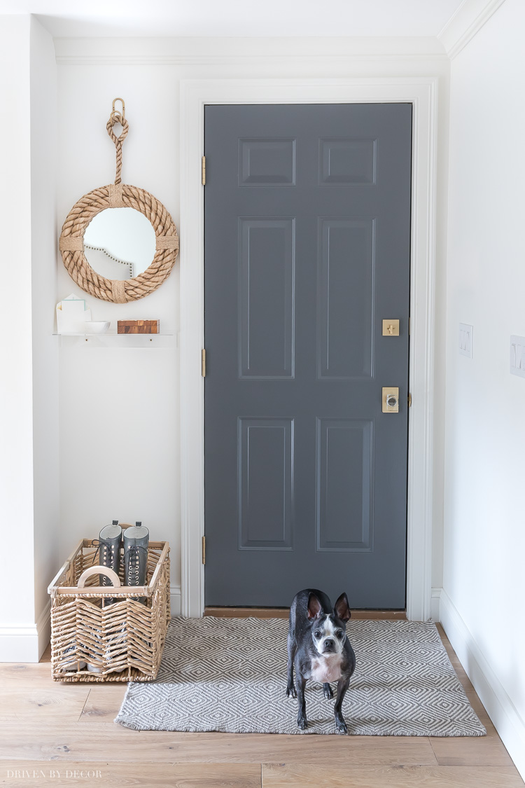 Excited to share our newly made-over garage entryway! Details on door paint color, rug, and more are linked in the post!