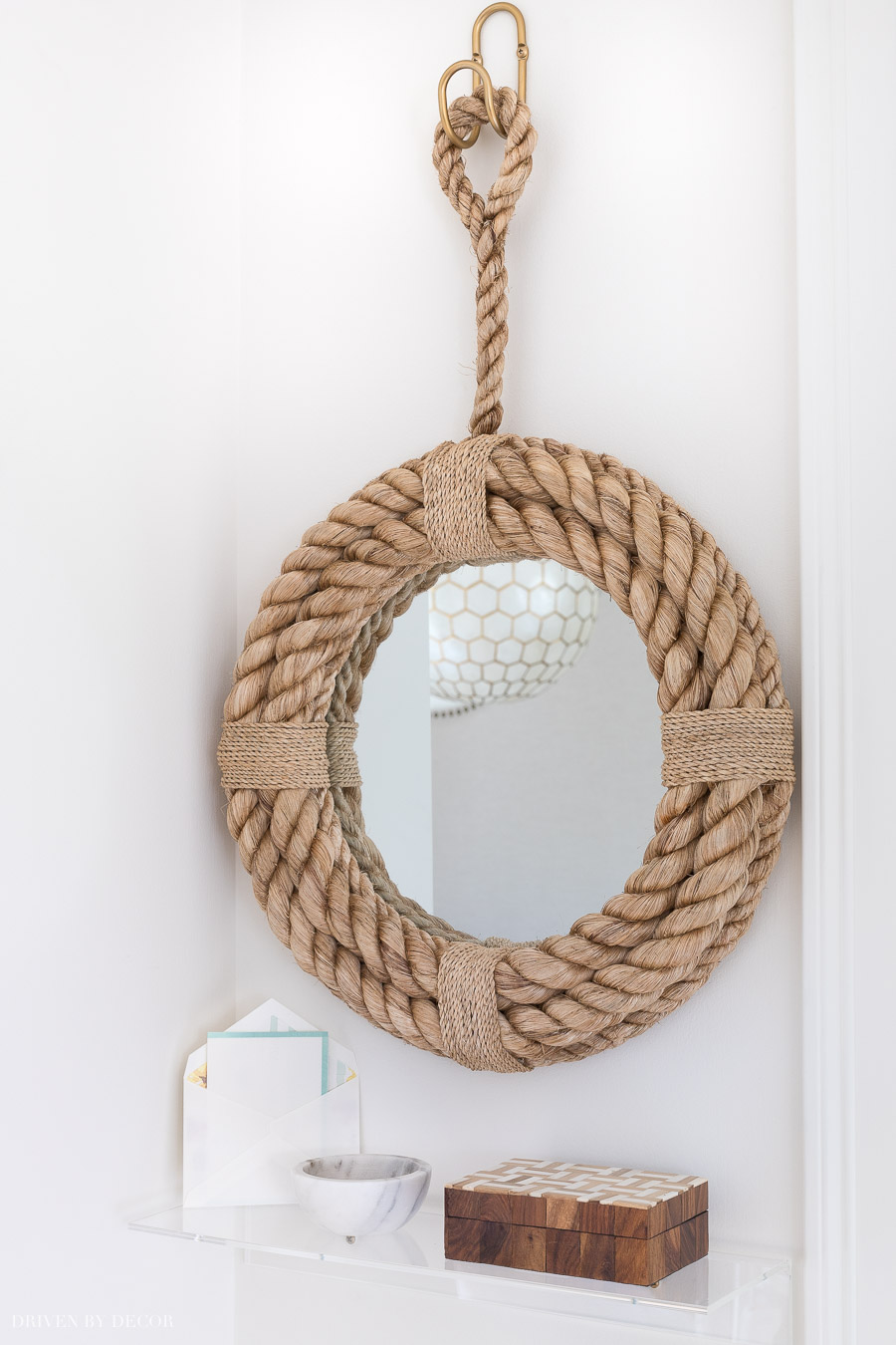 A rope mirror and small acrylic shelf - super cute decor for a small entryway