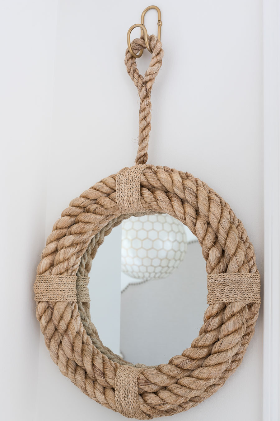 Darling round rope mirror that's perfect for a small entryway like this one going out to the garage!