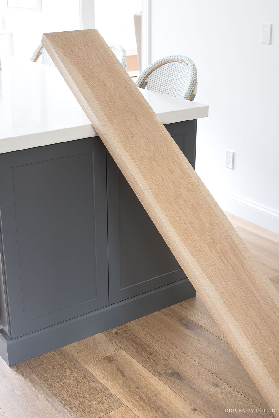 The white oak boards used to create the floating corner shelves in our kitchen