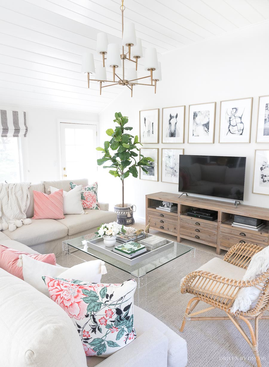 Our spring family room! Loving the floral pillows and tasseled basket from the Flower Home collection!