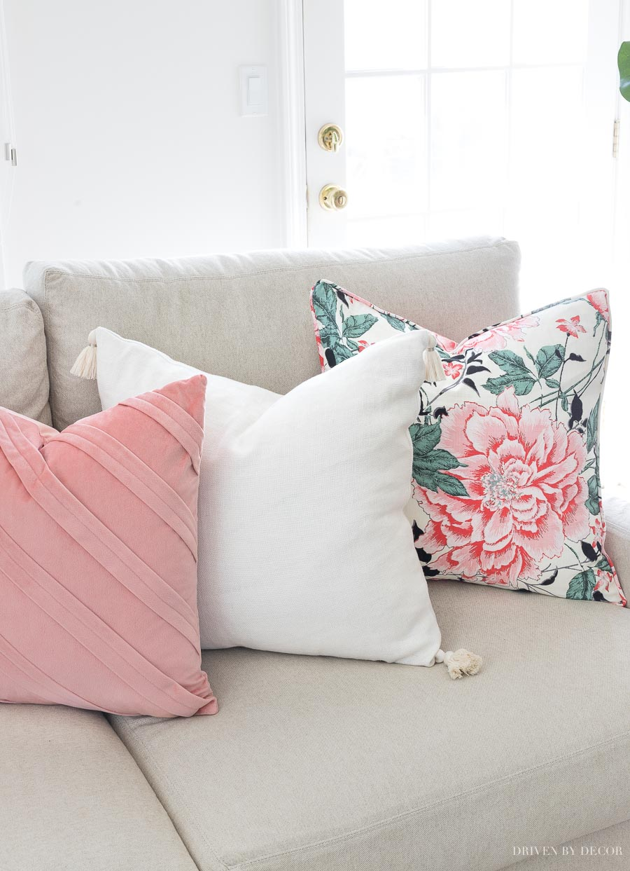 Loving this combination of spring pillows with a floral pattern, solid cream tasseled pillow, and pleated blush velvet!