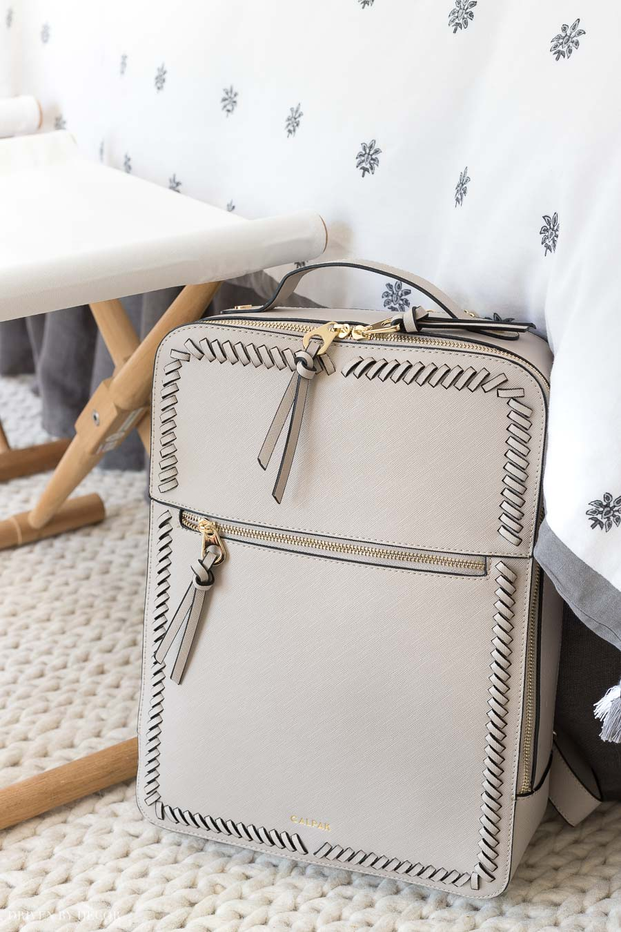 LOVE this stylish laptop backpack that's roomy enough to hold a laptop and a whole lot more!