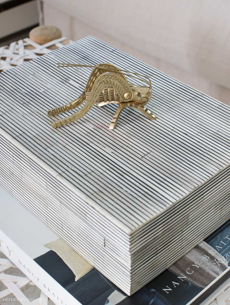 The cutest brass cricket and black and white striped box! Perfect coffee table accessories!