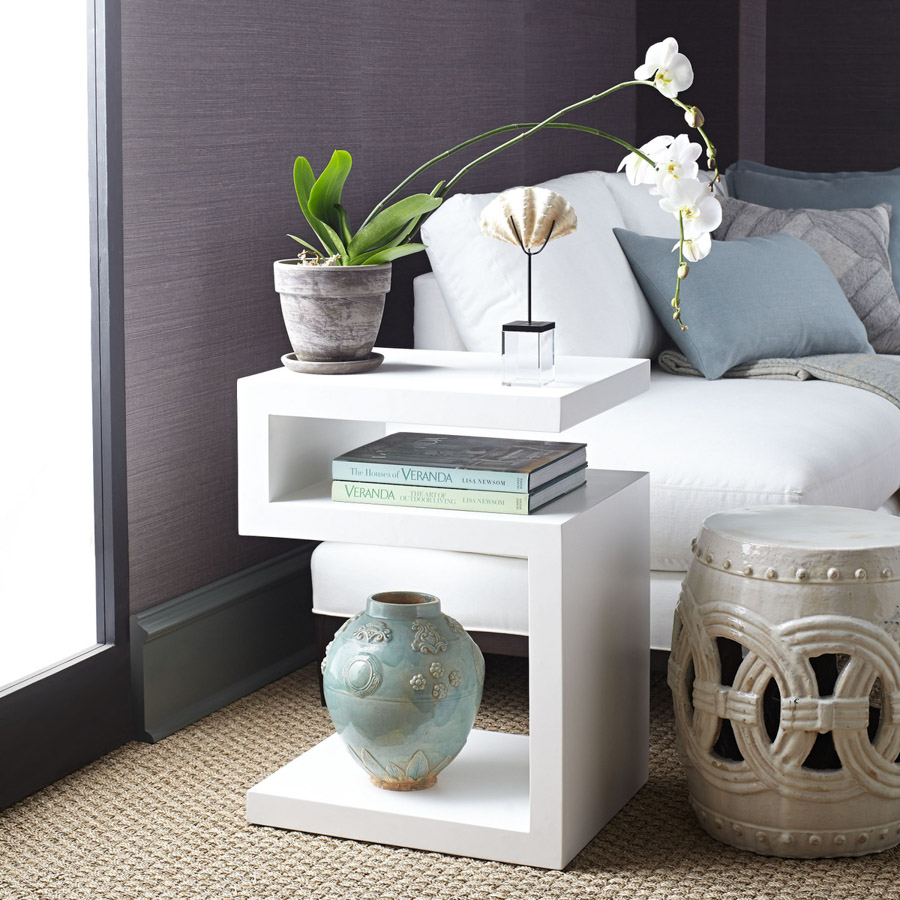 LOVE this S-shaped end table that can also double as a nightstand!