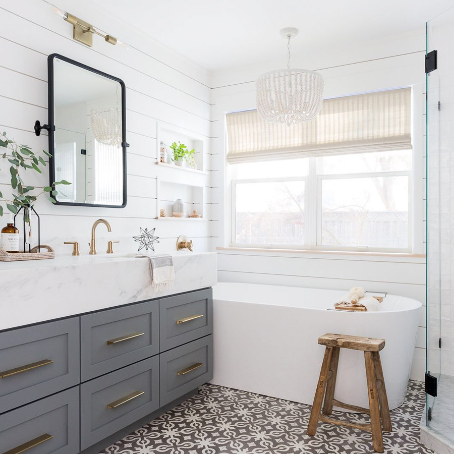 Love how they were able to add a bathtub in a smaller bathroom! Gorgeous!