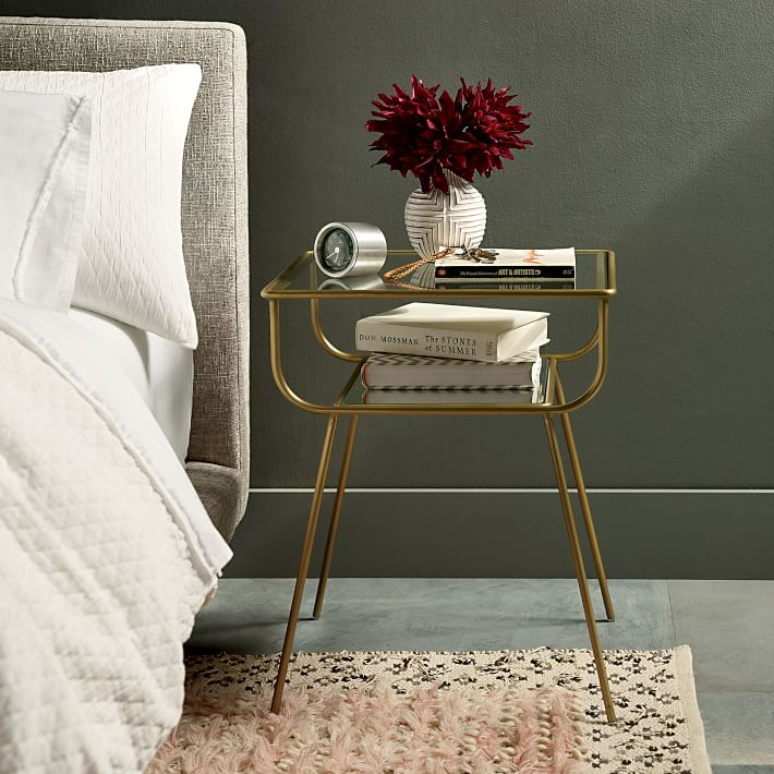 The perfect small space nightstand! Love how open and airy it is with the brass and glass combo!