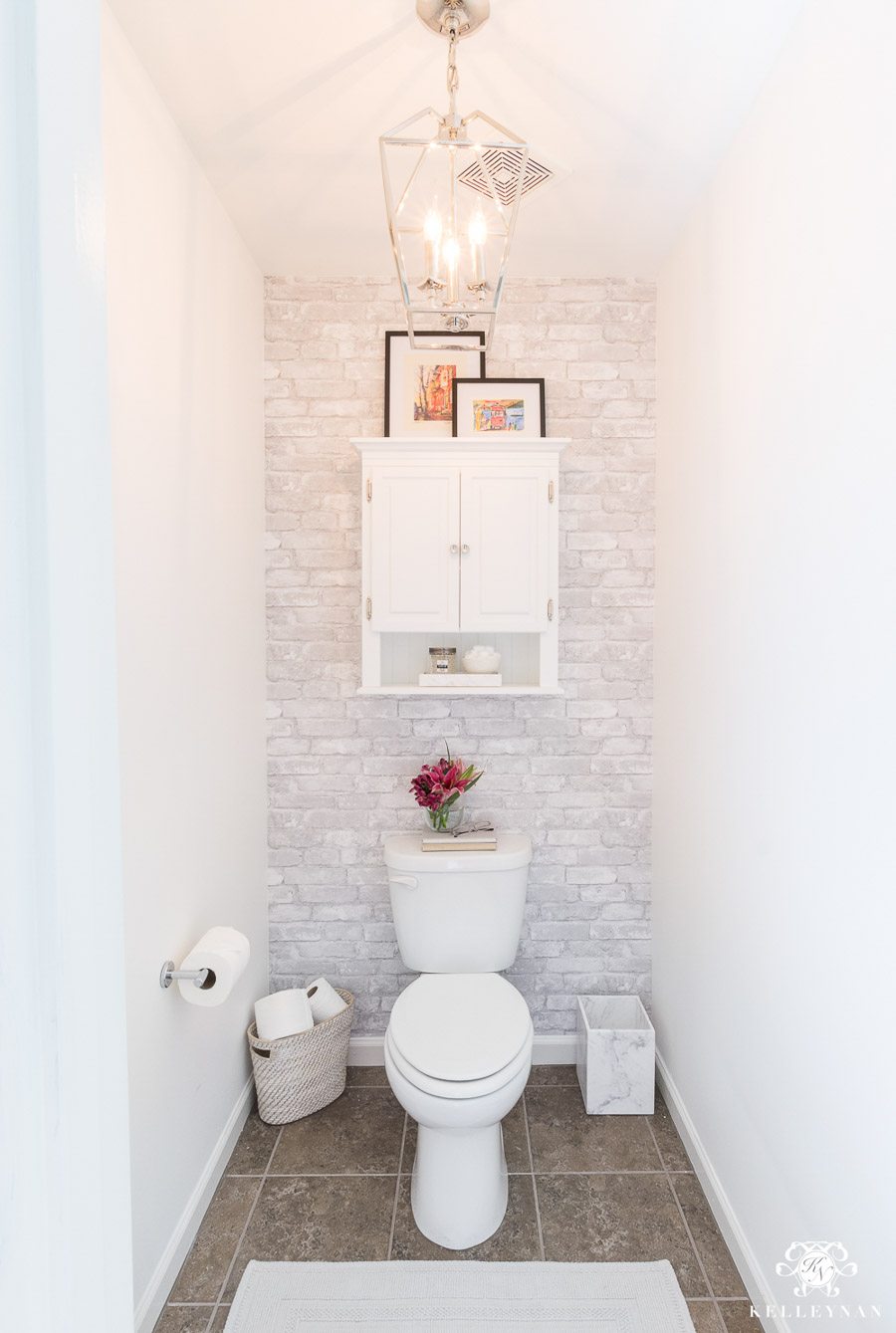 Love having a separate toilet area in master bathrooms like this beauty from the home of Kelley Nan