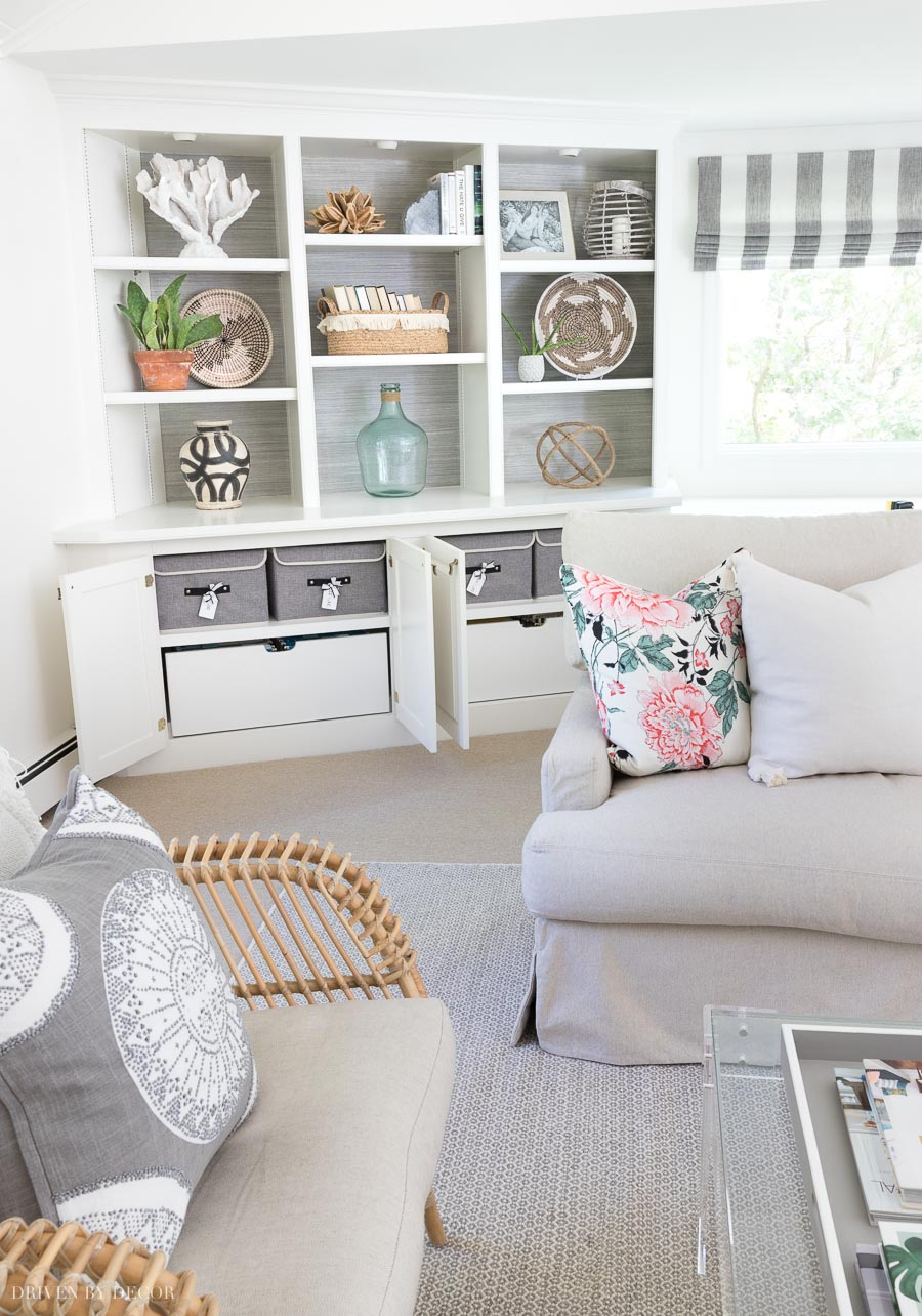 These lidded storage boxes for my pillow covers fit perfectly in the cabinets of our family room bookcase!